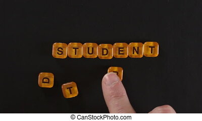 Letter Blocks Spell Student Debt - A close up shot of a man...