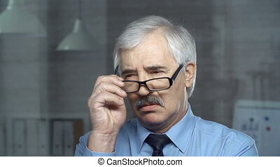 Thoughtful Man - Close up of white-headed businessman taking...