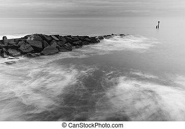 White waves splashing over rocks - Milky waves splashing...