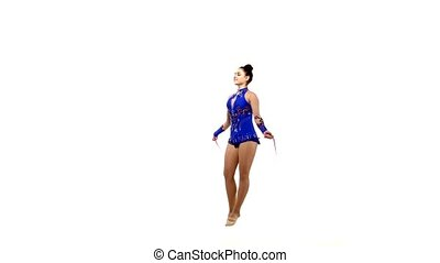 Beautiful artistic gymnast jumping rope on white background