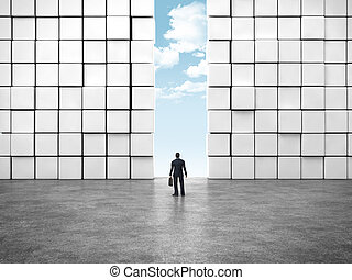 business man standing before entrance with sky background.