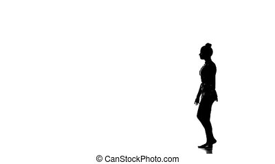 Young girl doing gymnastics , isolated over white - Young...