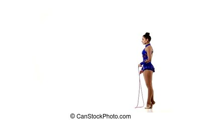 Professional artistic gymnast performs tricks with a rolling...
