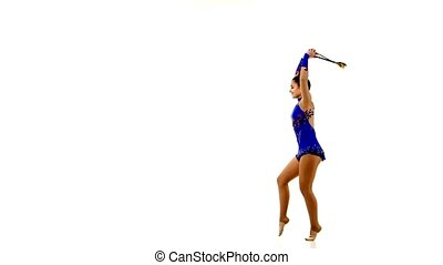 Pretty young woman doing exercises with Juggling clubs