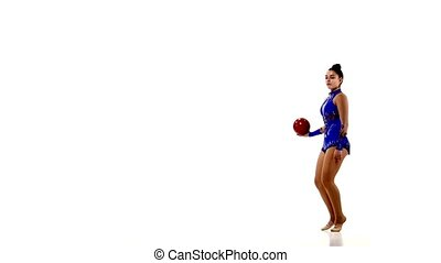 Young beautiful gymnast with ball