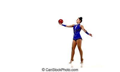 Active young girl gymnast with acrobatics ball on a white...