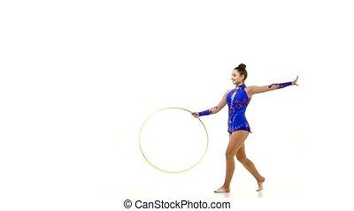 Woman doing exercises with hula hoop, - Woman doing...