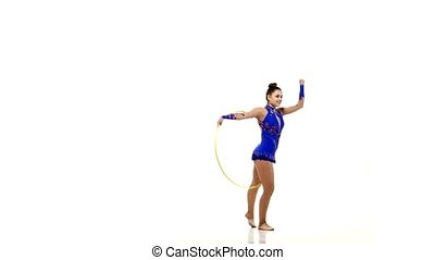 Beautiful woman gymnast with hula hoop in a blue tracksuit...