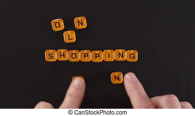 Letters Spelling Online Shopping - A close up shot of a man...