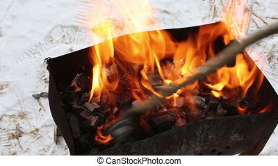 mixing charcoal grill in the winter mongale