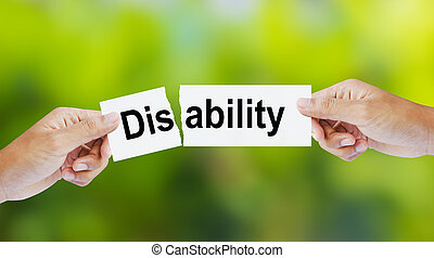 The word Disability for Ability - Businessman tearing the...