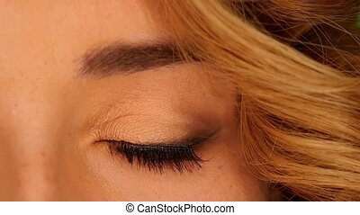 Beautiful grey eye of young attractive blond woman, close up...