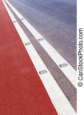 road stud with white reflector and red path