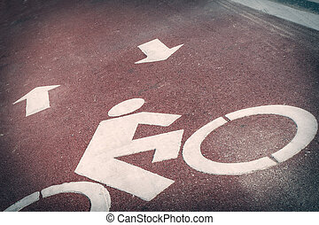 Bicycle lane or path, icon symbol on red asphalt road