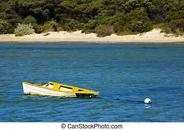 The sinking boat - A small yellow boat tied to a mooring is...