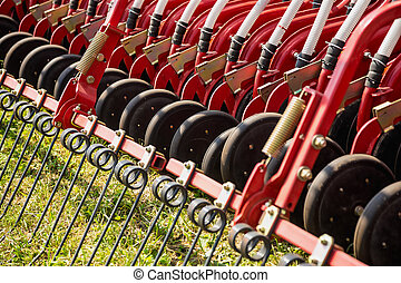 Hay rake farm machinery equipment in agricultural or...