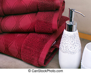 Towels - Stack of towels and liquid soap bottle