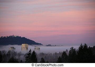 High mountain sunrise fog