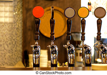 Row of Beer Taps in Bar - Close Up of Row of Shiny Beer Taps...