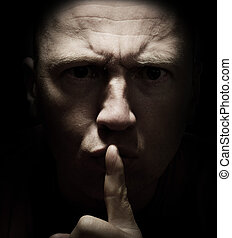 don't tell anyone! - Concept of don't tell anyone! a dark...