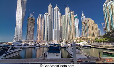 Dubai Marina with skyscrapers and boats in Dubai Hyperlapse...