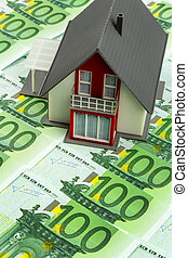 house on bills - house on banknotes, symbolic photograph for...