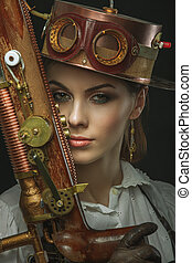 close-up portrait of steampunk girl with a gun in his hand.
