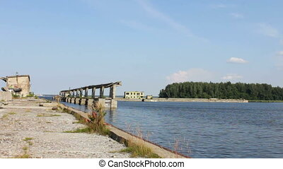 Ruined Buildings in Water - Abandoned ruins of harbour by...