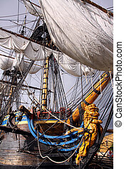 three-master ship with golden figurehead