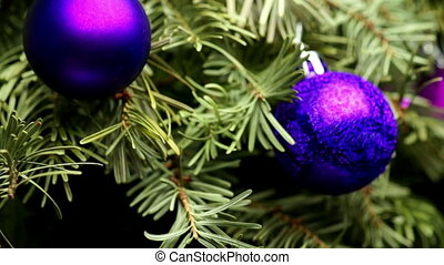 Coniferous Tree with Colorful Balls Rotate on a Dark...