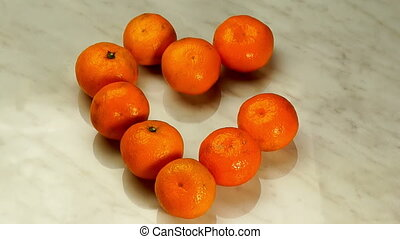 Mandarins in the Form of Heart Disappear