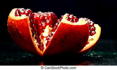 Open Pomegranate Rotates on a Dark Background