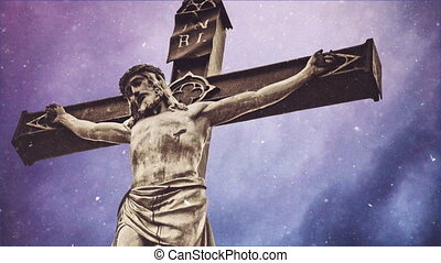 Crucifixion cross with Jesus Christ statue over stormy...