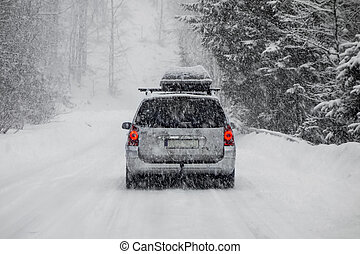 Car in snow - Car driving during winter snow taken through a...