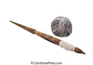 Slavic traditional spindle with wool isolated on white...