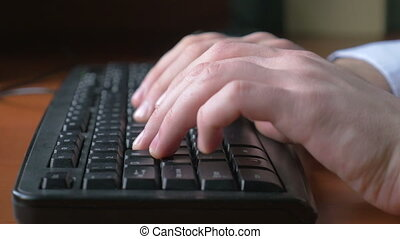 Man hands typing on a keyboard - 4k UHD - Close-up of a...
