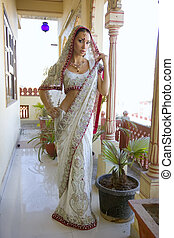 Beautiful young indian woman in traditional clothing with...