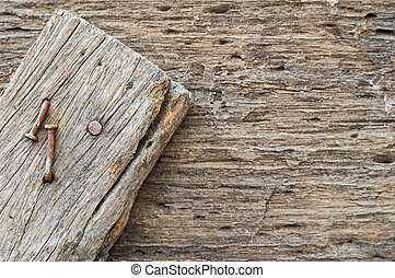 Nails adhere on wood plank wooden background