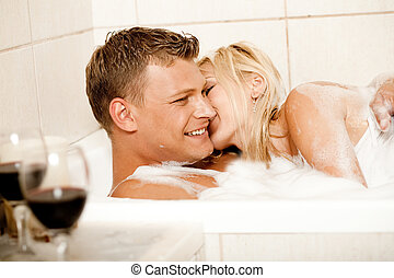 Time for erotic bath - Pretty female kissing man on his...