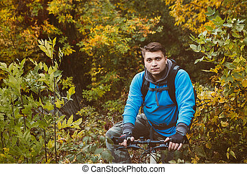 mountain bike race in a forest in denmark,  Shot with low shutter speed to achieve motion blur