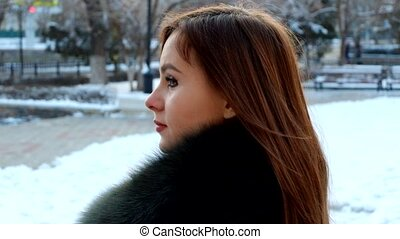 Young woman winter portrait. Full HD footage