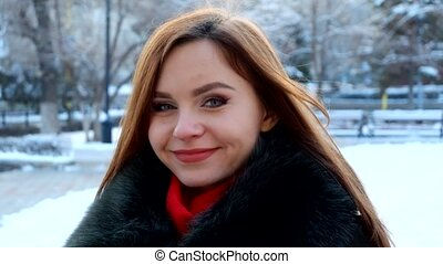 Young smiling woman winter portrait Full HD footage - Girl...