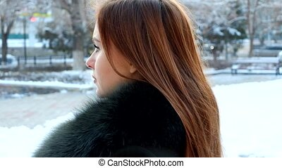 Girl turning to camera. Young woman winter portrait. Full HD footage