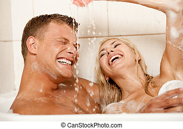Bathroom games - Playful couple enjoying in bath