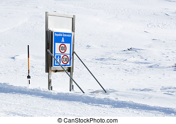 Speed limit at the border crossing of Austria in snowy...