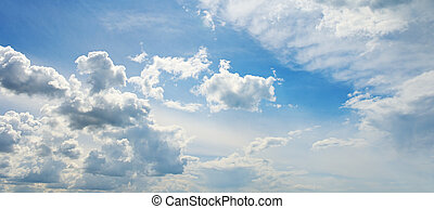 white fluffy clouds in the blue sky...