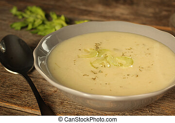 Celery soup on a rustic background