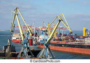 Yellow cranes and container ship in Odessa sea port