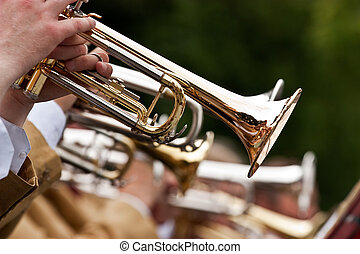 trumpet player - A musician is playing his golden trumpet