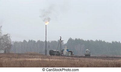 Natural gas torch burning at gas extraction station